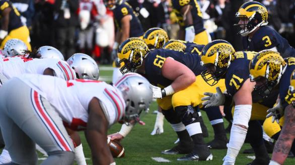 Nov 28, 2015; Ann Arbor, MI, USA; Michigan Wolverines offensive line lines up against the Ohio State Buckeyes defense line during the game at Michigan Stadium. Mandatory Credit: Tim Fuller-USA TODAY Sports